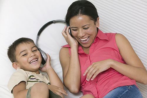 Woman and Child Sharing Headphones